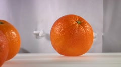 Cutting an orange into wedges Stock Footage