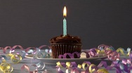 Stock Video Footage of Chocolate cupcake with one candle