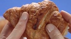 Breaking off a piece of croissant Stock Footage