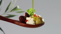 Pouring olive oil over feta and olives Stock Footage
