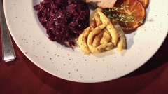 Roast pork with red cabbage, spaetzle noodles and sauce Stock Footage