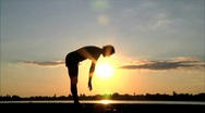 Girl playing sports at sunset Stock Footage