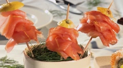 Salmon on cocktail sticks, sushi and tuna sandwiches - stock footage