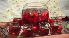 Strawberry punch in punch bowl and glasses Stock Footage