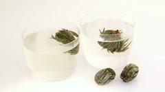 Jasmine tea flowers in two tea glasses Stock Footage