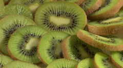 Kiwi fruit slices arranged in a circle Stock Footage