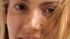 Young woman in wind Stock Footage