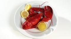 Cooked lobster with butter sauce and lemon Stock Footage