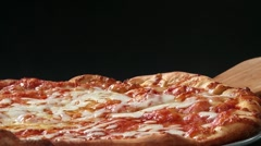Taking a slice of pizza with a pizza server Stock Footage