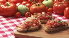 Bruschetta and fresh tomatoes Stock Footage