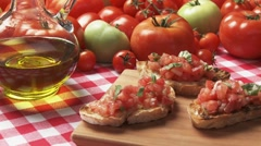 Bruschetta, olive oil and fresh tomatoes Stock Footage