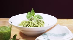 Spaghetti with pesto and Parmesan Stock Footage