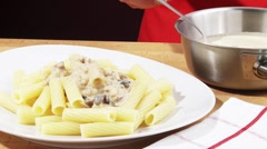 Serving out rigatoni with mushroom sauce Stock Footage