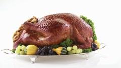 Roast turkey with autumn decorations on silver platter Stock Footage