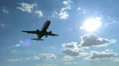 Airplane 720 60P flying overhead landing aproaching airport Stock Footage