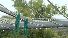 Rain and Washing Line Pegs Stock Footage