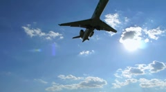Airplane   flying over head near airport Stock Footage