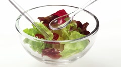 Pouring oil over mixed salad leaves Stock Footage