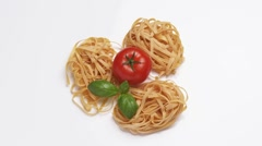 Tagliatelle with tomato and basil leaves Stock Footage