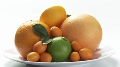 Assorted citrus fruit on plate Stock Footage