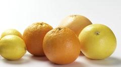 Grapefruits, oranges, lemons, limes and kumquats Stock Footage