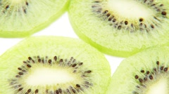 Slices of kiwi fruit, rotating Stock Footage