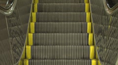 Escalator Descending - frontal with reflections.m2t Stock Footage