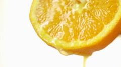 Orange juice dripping from half an orange Stock Footage