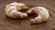 Nut croissants on melted milk chocolate Stock Footage