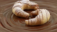 Nut croissant on melted milk chocolate Stock Footage