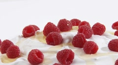 Cream with raspberries, honey and flaked almonds Stock Footage