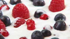 Yoghurt with fresh berries and berry sauce - stock footage