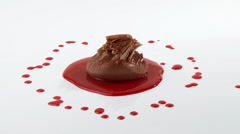 Mousse au chocolat with chocolate curls and berry sauce - stock footage