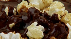 Popcorn with chocolate sauce Stock Footage