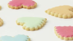Heart-shaped biscuits with pastel-coloured icing Stock Footage