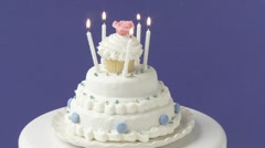 Birthday candles on a white cake Stock Footage