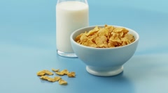 A bowl of cornflakes and a bottle of milk Stock Footage
