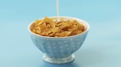 Pouring milk over cornflakes Stock Footage