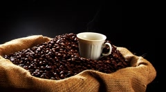 Sack of coffee beans and a cup of coffee Stock Footage