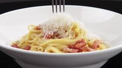 Twisting spaghetti carbonara around a fork Stock Footage
