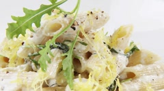 Penne with cheese sauce and rocket Stock Footage