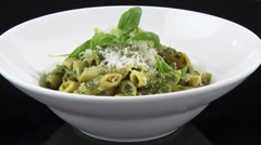Penne with pesto Stock Footage