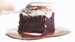 Brownie with cream and chocolate sauce Stock Footage