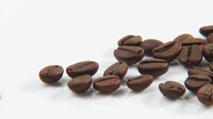 Coffee beans with spilt coffee Stock Footage