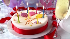 A birthday cake with burning candles Stock Footage