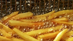 Deep-frying chips Stock Footage