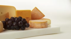 Various cheeses with grapes Stock Footage