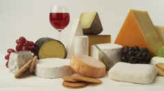 Various cheeses with wine, grapes and savoury biscuits Stock Footage