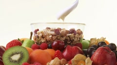 Assorted fruit and muesli with yoghurt Stock Footage