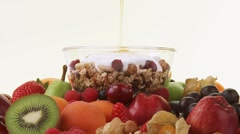 Assorted fruit and muesli with yoghurt and honey Stock Footage